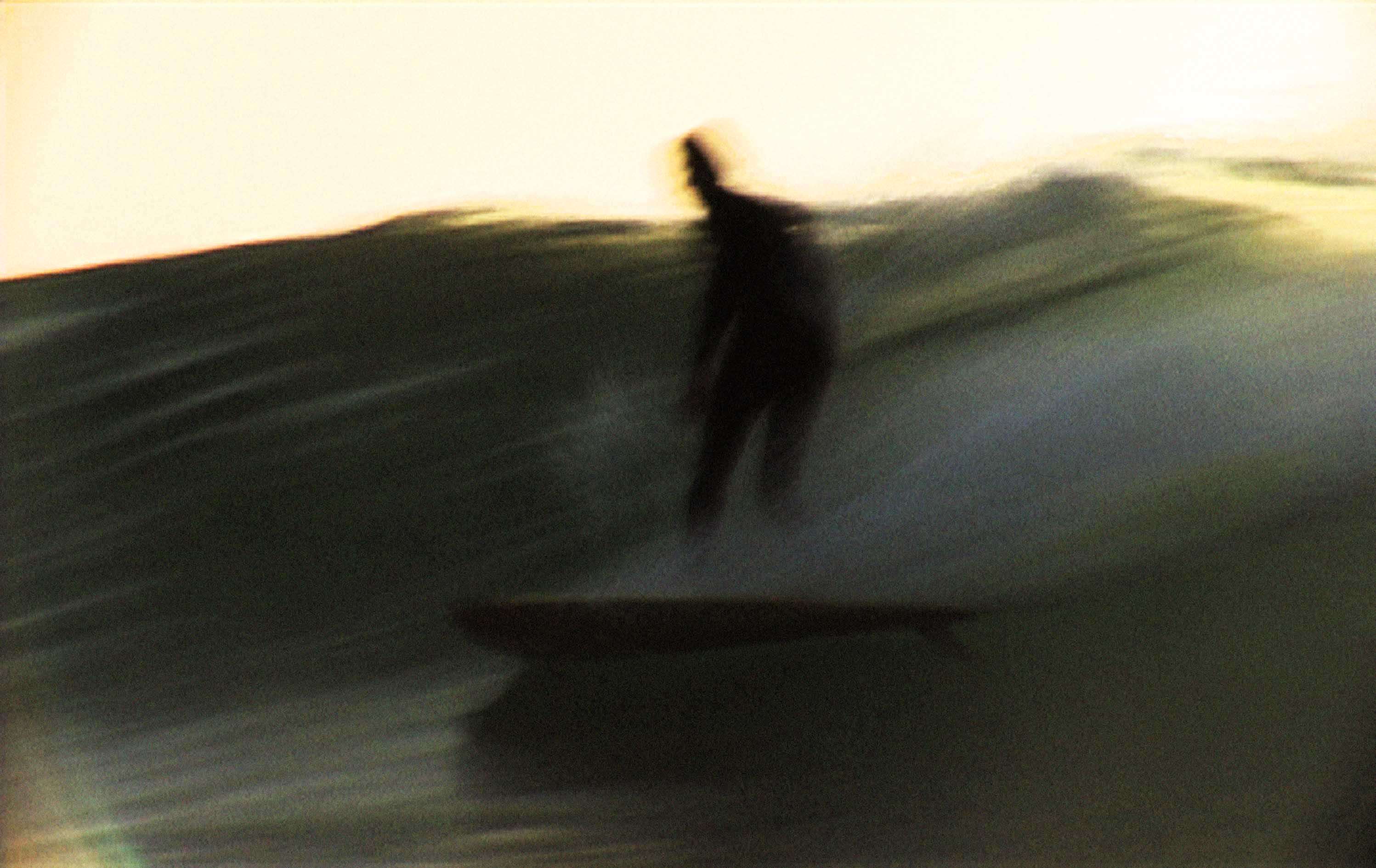 Still from Lost in the Ether riding Michael Peterson's surfboard